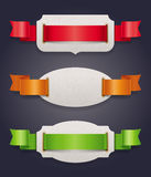 Labels with color silk ribbons Stock Photos