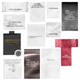 Labels de vêtements d'isolement Photographie stock