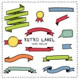 Labels et rubans tirés par la main Photo stock