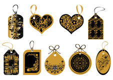 Labels in gold and black colors Royalty Free Stock Images