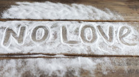 Labels love, couple, love, relationship, sugar, salt, bitterness on the background of the boards the background of snow Stock Image