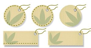 Labels made of natural fabric with embroidery. Royalty Free Stock Photo