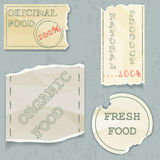 Labels of natural food on scraps of the old. Vecto stock illustration