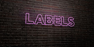 LABELS -Realistic Neon Sign on Brick Wall background - 3D rendered royalty free stock image. Can be used for online banner ads and direct mailers Royalty Free Stock Photography