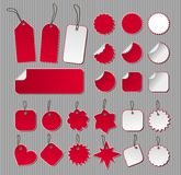 Labels in red and white. Over striped background Royalty Free Stock Photos