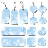 Labels with snowflakes. In blue Stock Photos