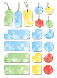 Labels with snowflakes in different colors. Labels with snowflakes in blue, red, yellow, green Royalty Free Stock Photography