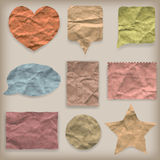 Labels or symbols of colored crumpled paper Stock Photography