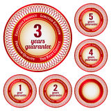 Labels From 1 To 5 Years Guarantee. Set of round red and gold stickers or labels from 1 to 5 years guarantee Royalty Free Stock Photos