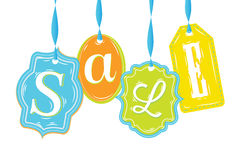 Labels of various forms with text Sale. In different colors with blue ribbons Stock Photography