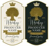 Labels for whiskey with crown and Oak Tree. Set of vector labels for whiskey premium quality in the figured frame with oak tree, crown, ribbon and handwritten Stock Photo