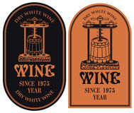 Labels for wine with a wine press and barrel. Set of vector labels for dry white wine with a wine press and barrel in retro style in red and black colors Royalty Free Stock Photography