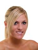 Labio más inferior penetrante del retrato rubio joven de la mujer Imágenes de archivo libres de regalías