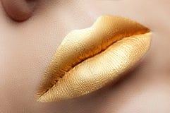 Labios del oro Imagen de archivo libre de regalías