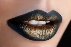 Labios del oro Imagenes de archivo