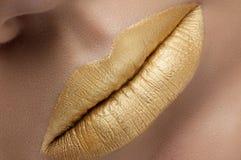 Labios del oro de la moda Imagenes de archivo