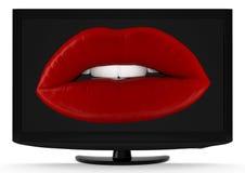 Labios deliciosos en la pantalla del LCD Foto de archivo