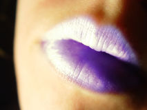 Labios púrpuras Fotos de archivo