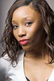 Labios que ponen mala cara de la mujer Foto de archivo libre de regalías