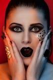 Labios y ojos negros de la moda Foto de archivo