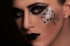 Labios y ojos negros de la moda Imagen de archivo libre de regalías