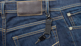 Lable and key. Jeans with lable and key Royalty Free Stock Image