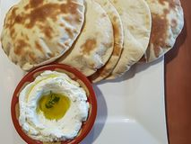 Labneh cream cheese dip with bread; Lebanese food royalty free stock images