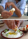 Labneh Dipping and Offering. A man dipping pita bread in labneh and offering it Stock Photo
