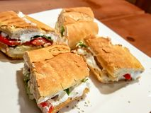 Labneh sandwiches, bread and creamy yoghurt cream cheese spread, on a white plate. royalty free stock photography