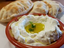 Labneh, delicious Lebanese yoghurt cream cheese and pita bread royalty free stock photos