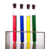 Labolatory glassware with colorful fluids isolated stock photography