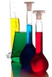 Labolatory glassware with colorful fluids isolated Royalty Free Stock Photo