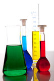 Labolatory glassware with colorful fluids isolated Royalty Free Stock Photos