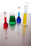 Labolatory glassware with colorful fluids isolated Stock Photos