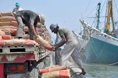 Labor activity at the port of Sunda Kelapa, Jakarta Royalty Free Stock Images