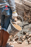 Labor carry sand in cistern for construction Royalty Free Stock Photo