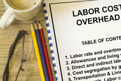 Labor cost. And overhead cost- concept for  rates and expenditures Stock Photo
