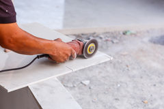 Labor cutting tile floor for new house building Royalty Free Stock Photo