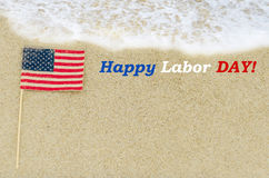 Labor day background on the beach. Labor day background with American flag on the sandy beach Stock Photos