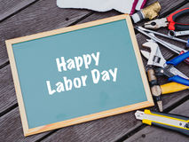 Labor day background concept. Jeans, many handy tools with labor day text on Jeans background top view Royalty Free Stock Photo