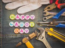 Labor day background concept. Jeans, many handy tools with labor day text on Jeans background top view Stock Photography