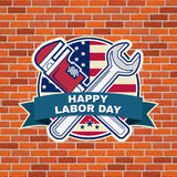 Labor day badge emblem with wrenches and American flag. Stock Photo