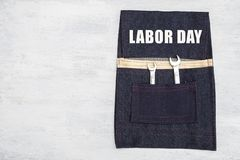 Labor day on blue jean tool bag with space on white texture background. Tool on blue tool bag royalty free stock images