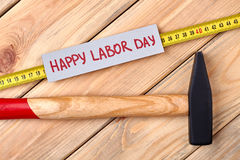 Labor Day card and hammer. Tools and card on wood. Symbolism of Labor Day Stock Photo