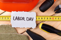Labor Day card with tools. stock images