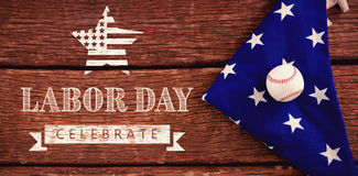 Composite image of labor day celebrate text and star shape american flag. Labor day celebrate text and star shape American flag against baseball on an american Royalty Free Stock Photography