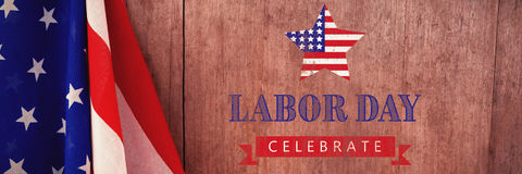 Composite image of labor day celebrate text and star shape american flag. Labor day celebrate text and star shape American flag against american flag on a wooden Royalty Free Stock Images