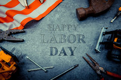 Labor day concept. Construction tools with text for Labor day Stock Image