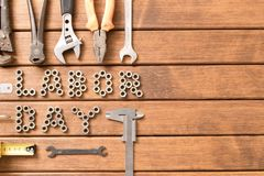 Labor day. Different tools on wooden background . With free space for text royalty free stock photography