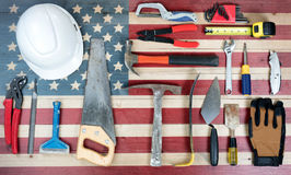 Labor Day holiday background with USA rustic wooden flag and man Stock Images